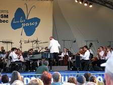 Outdoor concert of the Montreal Symphony Orchestra with conductor Jean-François Rivest in the borough of Pierrefonds-Roxboro in August 2008.