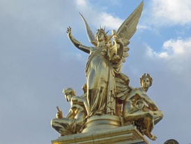 Gumery's L'Harmonie (1869), atop the left avant-corps of the façade, is 7.5 metres (25 ft) of gilt copper electrotype