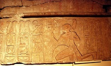 Ankhefenmut kneels before the royal cartouche of Siamun, on a lintel from the Temple of Amun in Memphis.