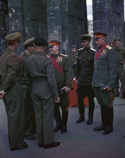 Marshal Georgy Zhukov (center) wearing three Hero of the Soviet Union medals and Marshal Konstantin Rokossovsky (right) wearing two