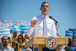 Garcetti speaking at a rally for increasing the minimum wage in 2014