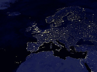 Satellite picture of Europe by night. Lights reveal the urbanized areas of Europe. It also shows the Blue Banana megalopolis from north-west England to northern Italy, and Golden Banana urbanized area between Genua and Valencia.