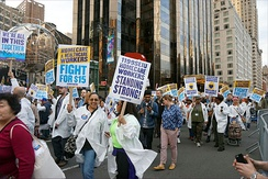 Unions and workers protesting together for higher wages (2015)