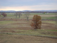 Southwest view of the Sherfy farm (right background) from the Pennsylvania Monument observation deck, 1 of 6 on the battlefield:  3 on towers (Warfield Ridge), Oak Ridge, Culp's Hill), 1 on Little Round Top, & 1 on the closed Cyclorama Building.