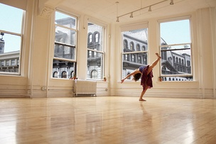 A dancer practices in a dance studio, the primary setting for training in classical dance and many other styles