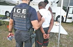 ICE officer detaining a suspect