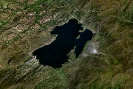 Satellite view of Lake Tota. Aquitania is the town in the east side of the lake