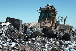 A landfill compaction vehicle in action.