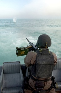 An M2 fired from a rigid-hulled inflatable boat.