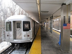 An M shuttle train at Middle Village–Metropolitan Avenue during reconstruction of the Myrtle Avenue Line's junction with the BMT Jamaica Line