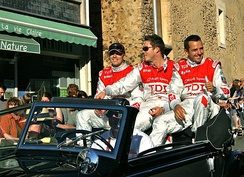 Tréluyer with André Lotterer and Marcel Fässler at the 2010 24 Hours of Le Mans drivers' parade