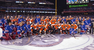 Former Flyers and Rangers players pose after the Alumni Game, held as part of the 2012 NHL Winter Classic