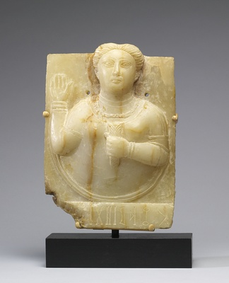 A Sabaean priestess, who intercedes with the sun goddess on behalf of the donor. Probably first century.