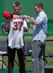 Strasburg (left) receiving a Nationals uniform from Ryan Zimmerman, August 2009