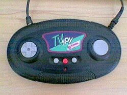 A handheld TV game with power and TV leads attached.