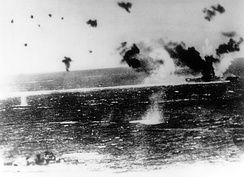Lexington (center right), afire and under heavy attack, in a photograph taken from a Japanese aircraft