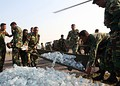 Bangladesh Army soldiers unload a shipment of bottled water for cyclone victims.