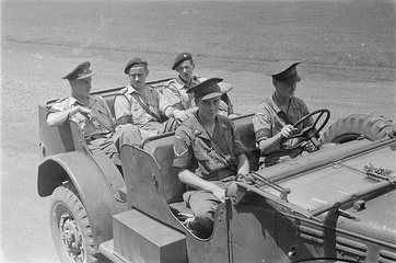 Five Royal Dutch Marechaussee riding in a WC-56/-57 Command Car – 1946, Bogor, West Java, during the Indonesian war of independence.
