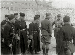 IPN copy #42Askaris assigned to the operationStroop and foreign fighters at the Umschlagplatz, with Stawki 5/7 in the back.