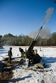 Canadian soldiers fire a high explosive round with a C3 howitzer in 2009.