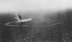 USS Neosho is left burning and slowly sinking at the completion of the Japanese dive bombing attack.