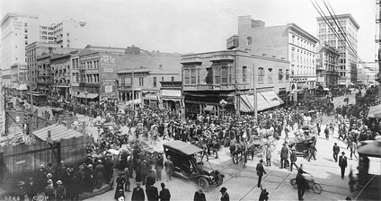 Huge crowds surround the All Night And Day Bank on the corner of Spring Street and Sixth Street, April, 1910