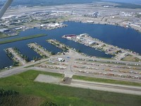 Aerial view of Lake Hood Seaplane Base (foreground) and Ted Stevens Anchorage International Airport (background).
