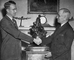 Receiving the Collier Trophy from President Harry Truman, White House, 1946
