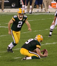 A placekicker attempts a field goal by kicking the ball from the hands of a holder.