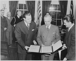 Postmaster General Robert E. Hannegan, (left) with the President Harry S. Truman at the Oval Office, in 1946.