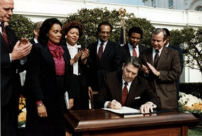 Ronald Reagan and Coretta Scott King at the Martin Luther King Jr. Day signing ceremony.