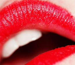 Red lipstick has been worn by women as a cosmetic since ancient times. It was worn by Cleopatra, Queen Elizabeth I, and film stars such as Elizabeth Taylor and Marilyn Monroe.
