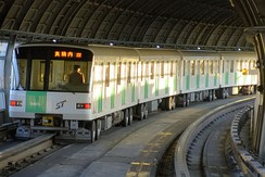 Sapporo Subway with a centrally placed guiding/return rail
