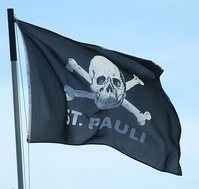 The Skull and crossbones symbol on a supporter flag.