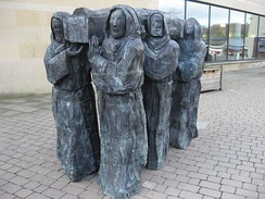 The Journey, a modern sculpture showing the travels of the Lindisfarne community, by Fenwick Lawson. Shown here in the Millennium Square, Durham.