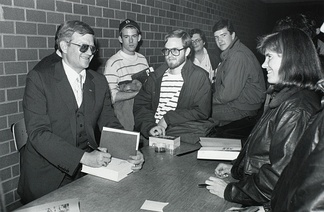 The popular demand for Tom Clancy's action novels exceeded his ability to write new books. As a result, his publisher hired ghostwriters to write novels in the Clancy style.