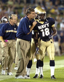 Coach Paul Johnson instructs a player during a game against Duke in 2004