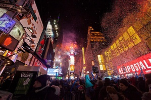 "A crowd gathered in New York City's Times Square at midnight during its annual ""ball drop""."