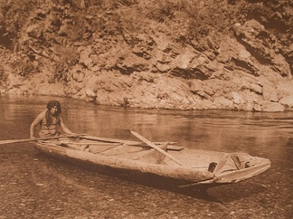 A Yurok man in a redwood canoe. These vehicles were prized among the Shasta.[3]