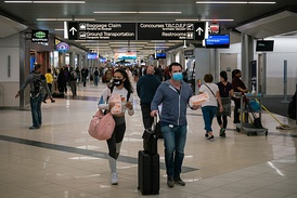 Flyers at Hartsfield-Jackson Atlanta International Airport wearing face masks on March 6, 2020 as the COVID-19 coronavirus spreads throughout the United States. Disproportionate numbers of cases have been observed among Black and Latino populations.[115][116][117]