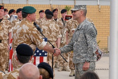 Royal Marines Maj. Gen. Andy Salmon, Multi-National Division-Southeast commander, and US Army Maj. Gen. Michael Oates in Basra, Iraq in 2009. RMBS personnel are behind.