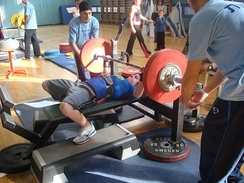 "A female athlete performing a bench press at the IPA world championship 2007, in the ""Bench Only"" category"