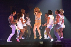 "Céline Dion on stage with her dancers performing ""River Deep – Mountain High"" on the Taking Chances World Tour in September 2008"