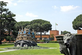 Decorative elements from Fellini's Casanova on the entrance lawn of the studios