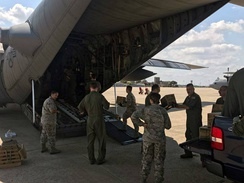 U.S. military relief crews load supplies aboard a C-130 Hercules aircraft from the Illinois Air National Guard's 182nd Airlift Wing based in Peoria. The C-130 and crew have been assisting with Hurricane Harvey relief efforts since Aug. 31. (Submitted photo.)