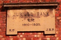 Jubilee Bank was built in the Arts and Crafts Vernacular style.