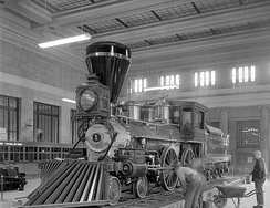 William Crooks locomotive being set up as a static display in the station's waiting room in 1954. The engine remained on display here until 1975, when it was moved to the Lake Superior Railroad Museum in Duluth.