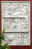 Reliefs at the Cpuncil of Ministers Building.Left The reliefs at the facade of the University Hospital in Tirana. Right