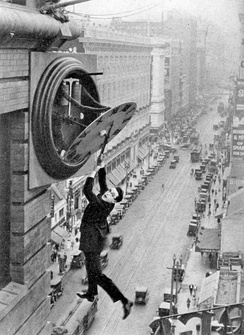 The iconic scene featuring Harold Lloyd hanging from the clock in Safety Last! has been referenced by numerous media, with a number of films including similar events in their plots.