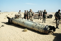 Military personnel examine the remains of a Scud